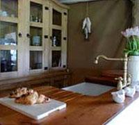 Kitchen sink with running water and dresser